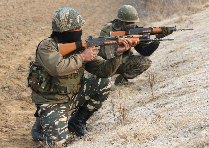 Soldiers take position during an encounter in Pulwama