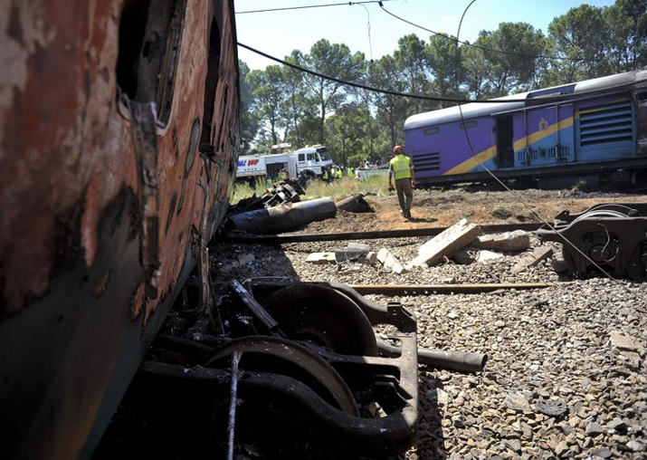 Ruined carriages at the scene of a train accident near