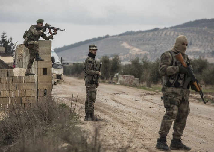 Turkey-backed Free Syrian Army fighters secure an area