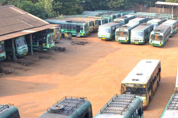 Buses remain parked at the depot following a flash strike
