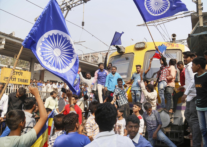 India Tv - Dalit groups protesting at Thane railway station during the Maharashtra Bandh on Wednesday following clashes between two groups in Bhima Koregaon near Pune