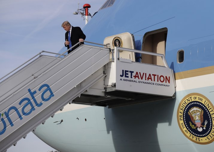 Donald Trump steps off Air Force One on arrival at Zurich
