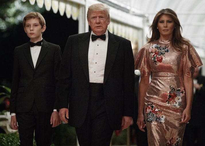 India Tv - President Donald Trump arrives for a New Year's Eve gala at his Mar-a-Lago resort with first lady Melania Trump and their son Barron