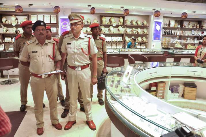 ED officials inspect a jewellery store during a raid in