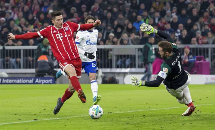 India Tv - Bayern Munich's Rober Lewandowski scores a goal.