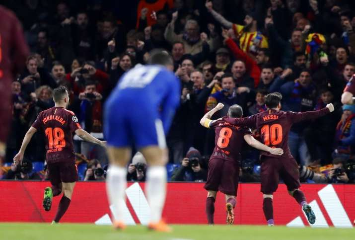India Tv - Chelsea players look on as FC Barcelona celebrate after scoring.