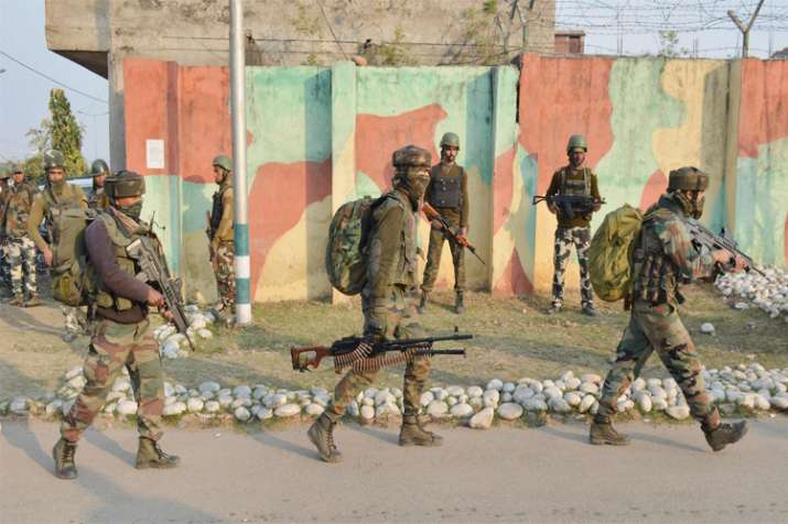 Security personnel take positions during a militants attack