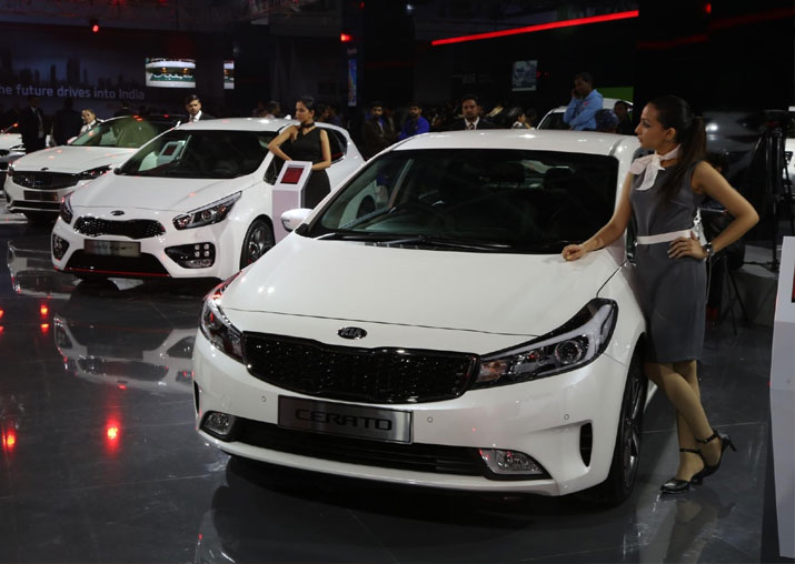 Models showcase Kia Cerato at Auto Expo 2018 in Greater