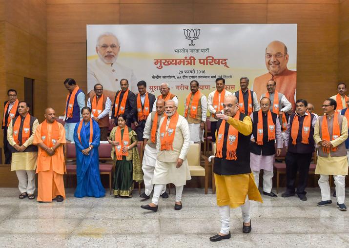 PM Modi asks BJP CMs to work hard to take govt's flagship