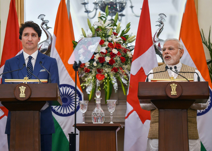 Prime Minister Narendra Modi speaks as his Canadian