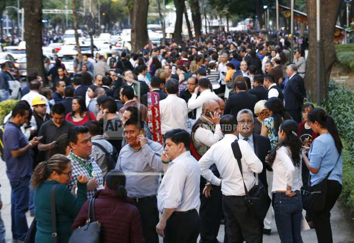 People stand along Reforma Avenue after a 7.2-magnitude