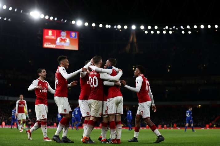 India Tv - Arsenal players celebrate after a goal