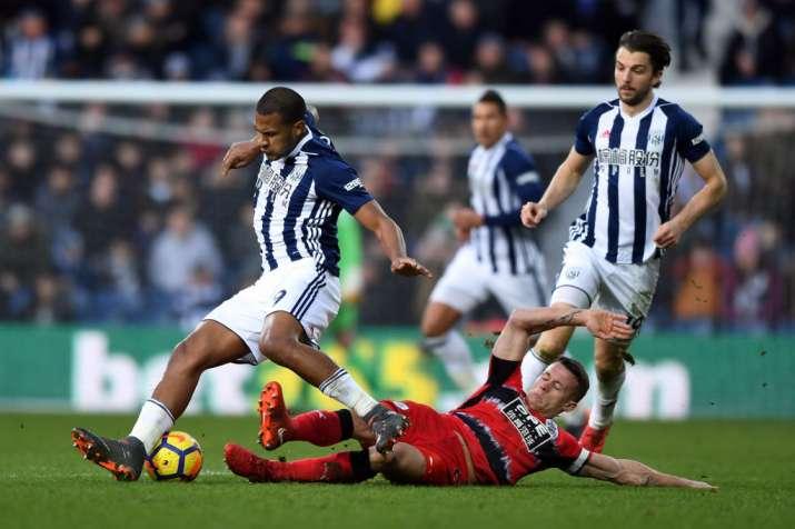 India Tv - Huddersfield's defeder tackles West Brom forwards