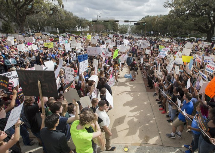 India Tv - Students gather on the steps of the old Florida Capitol protesting gun violence in Tallahassee, Fla., Wednesday, Feb. 21, 2018