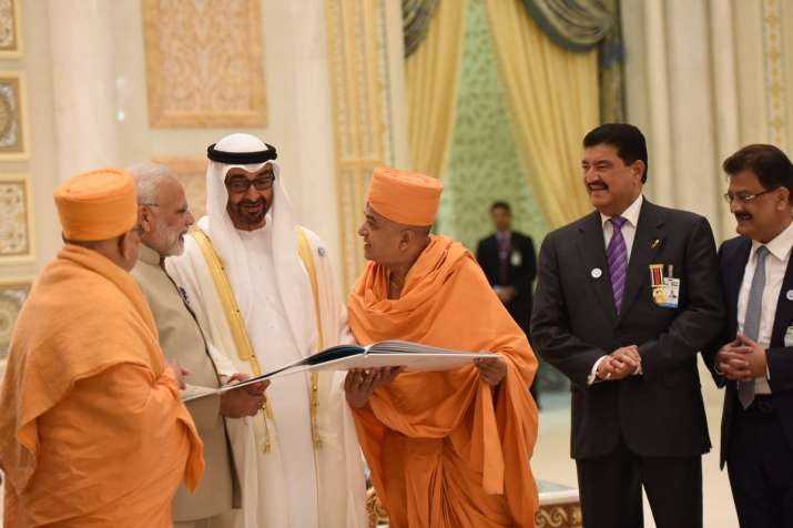 India Tv - Temple Committee members presenting the temple literature to the Crown Prince of Abu Dhabi and PM Modi.