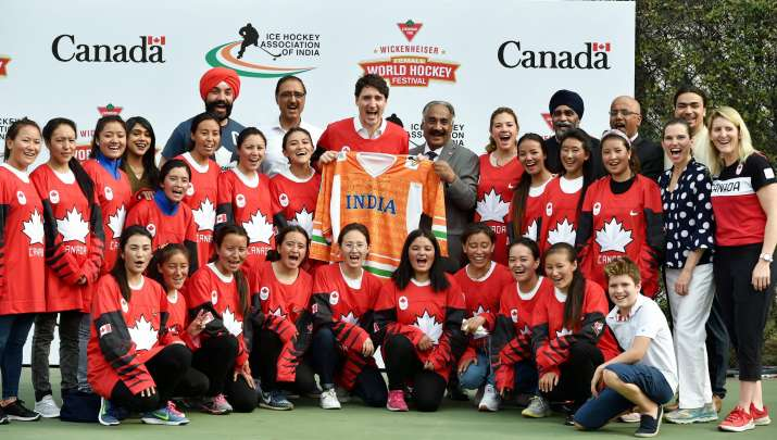 India Tv - Justin Trudeau posing with the children with the jersey