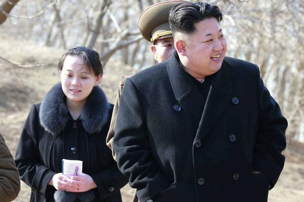A file photo of North Korean leader Kim Jong Un (right) and