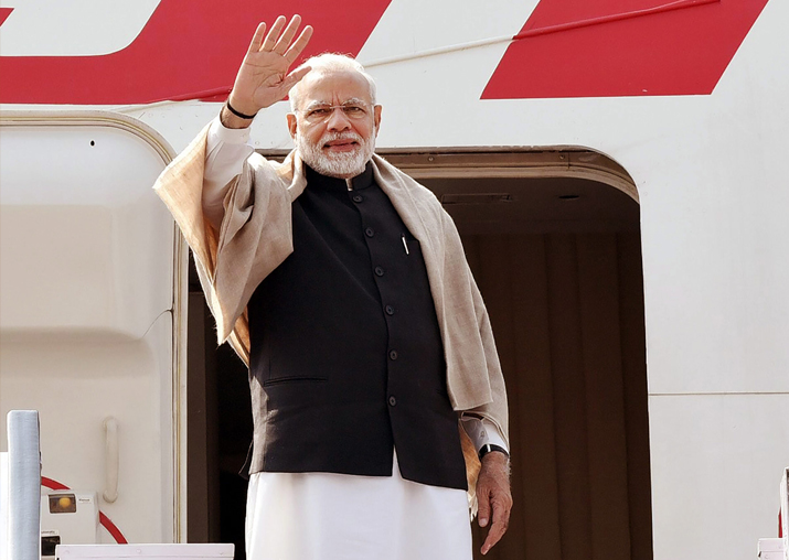 PM Narendra Modi waves as he embarks on a 4-day visit to