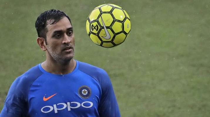 India Tv - MS Dhoni during a practice with a football