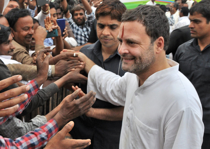Congress President Rahul Gandhi meets people during a rally