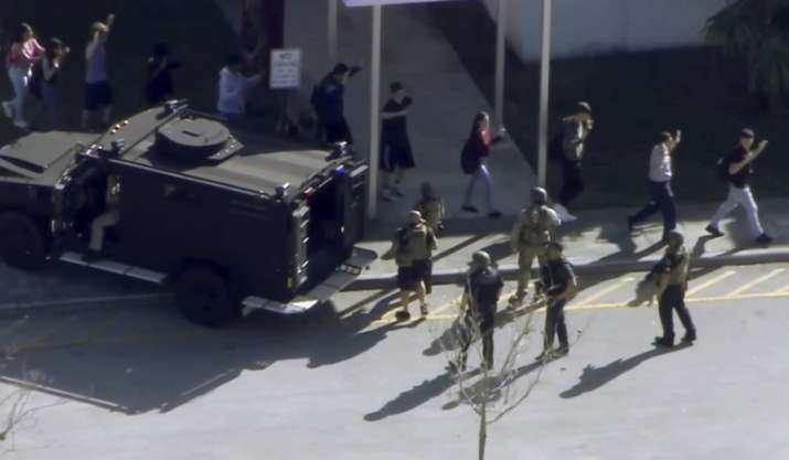 India Tv - In this frame grab from video provided by WPLG-TV, students from the Marjory Stoneman Douglas High School in Parkland, Fla., evacuate the school following a shooting, Wednesday, Feb. 14, 2018.