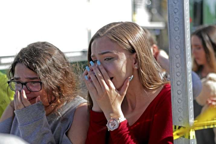 Students released from a lockdown are overcome with emotion