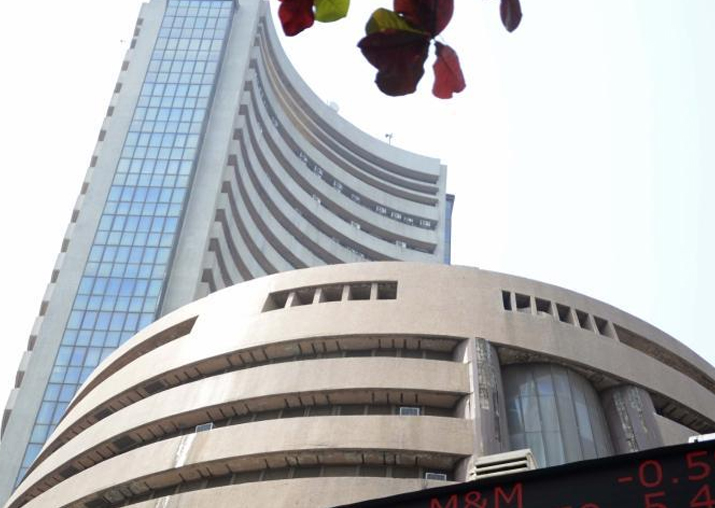 Markets retreat on global rout, Sensex falls 407 points to