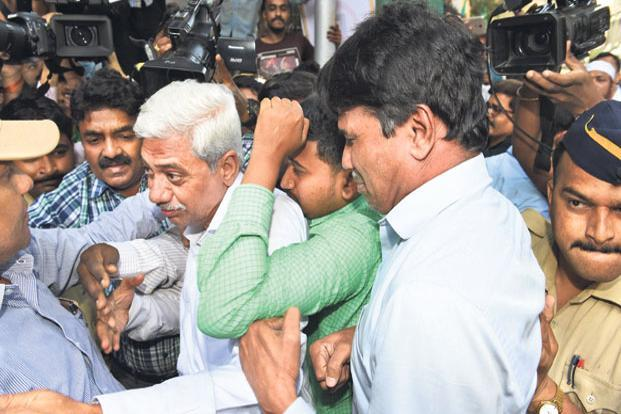 CBI officials escort Gokulnath Shetty (C, grey hair), the