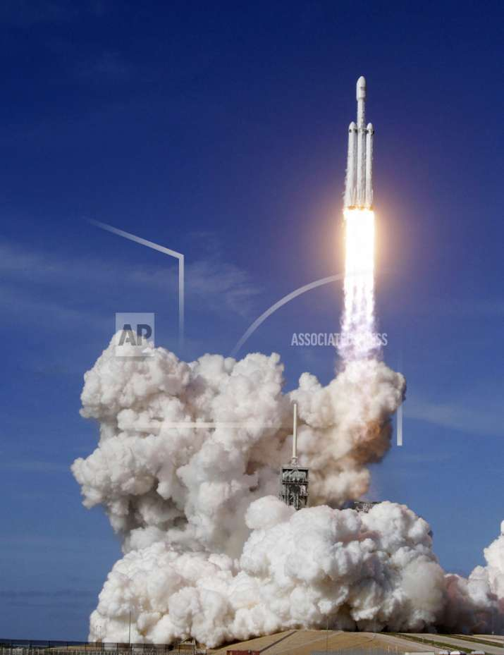 India Tv - A Falcon 9 SpaceX heavy rocket lifts off from pad 39A at the Kennedy Space Center in Cape Canaveral, Fla., Tuesday, Feb. 6, 2018. The Falcon Heavy, has three first-stage boosters, strapped together with 27 engines in all. (Red Huber/Orlando Sentinel via AP)