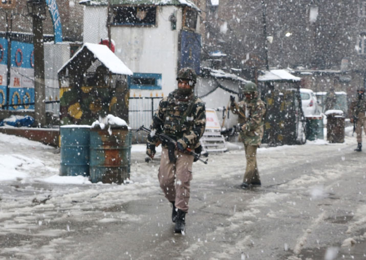 CRPF personnel conduct search operations amid snowfall