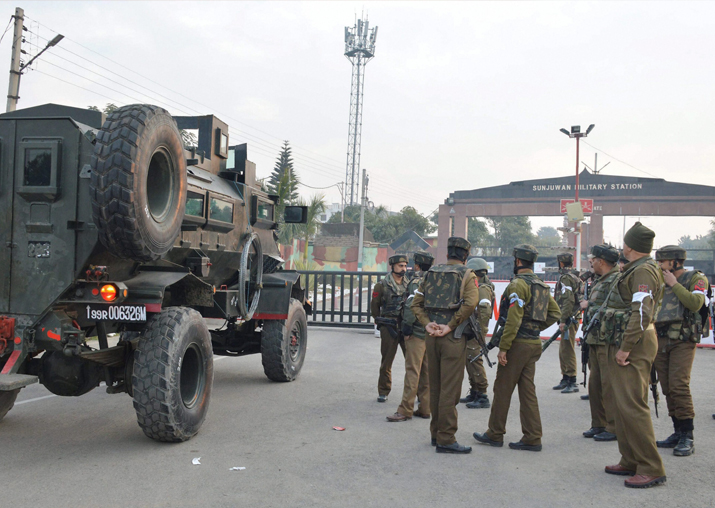 Security personnel stand guard outside the Sunjuwan Army