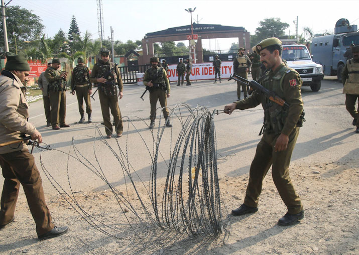 Security personnel place the barbed wires outside the