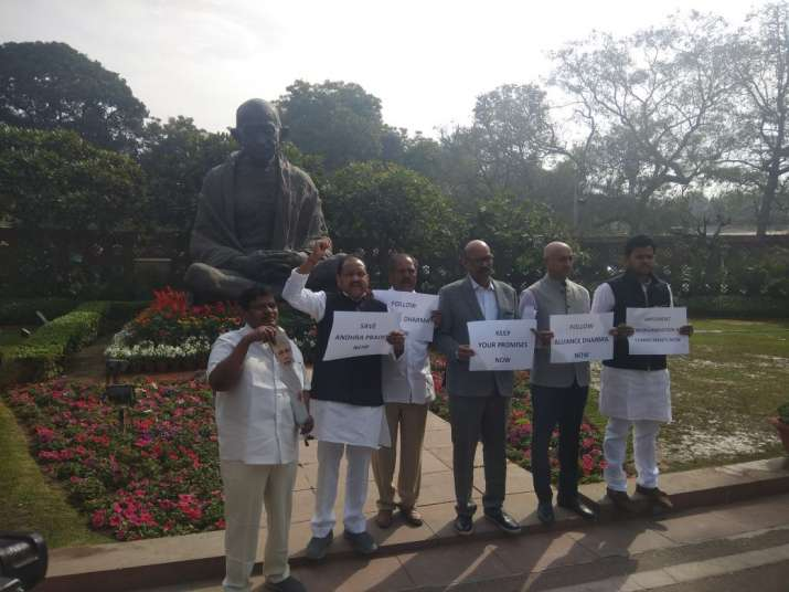 India Tv - TDP MPs stage protest at Gandhi statue in Parliament.