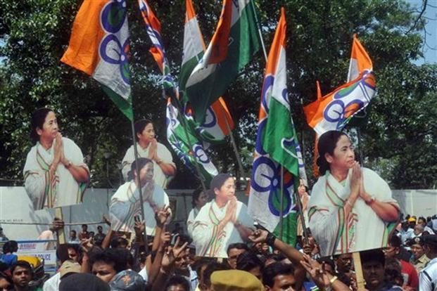 A file photo shows Trinamool Congress supporters carrying