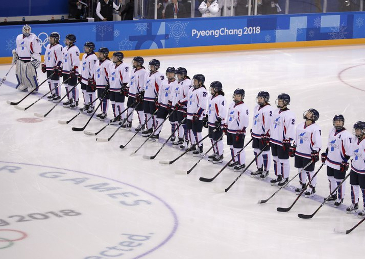 Players from the combined Koreas line up before the