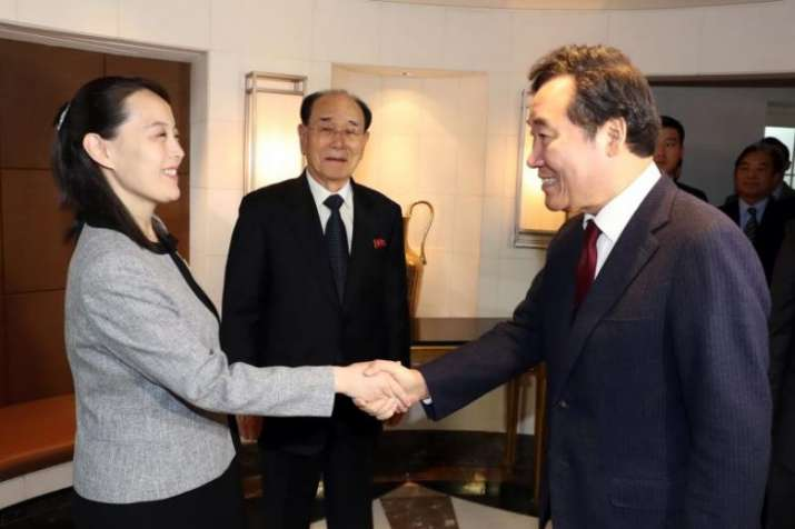 South Korean Prime Minister Lee Nak Yon (right) shakes
