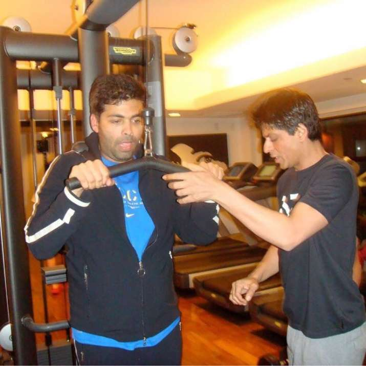 India Tv - Karan Johar gets trained by Shah Rukh Khan during a gym session.
