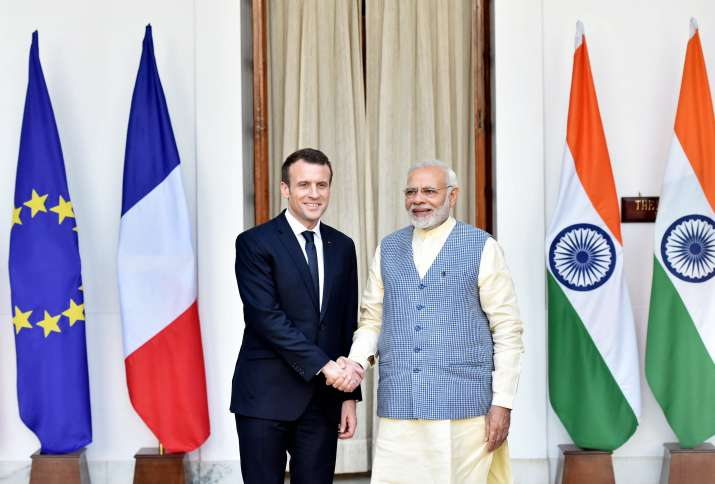 French President Emmanuel Macron with PM Narendra Modi.