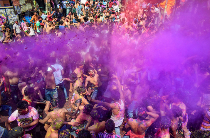 India Tv - Revelers smear colour in the air as they joyfully dance during the 'Holi' festival celebration, in Allahabad on Friday.