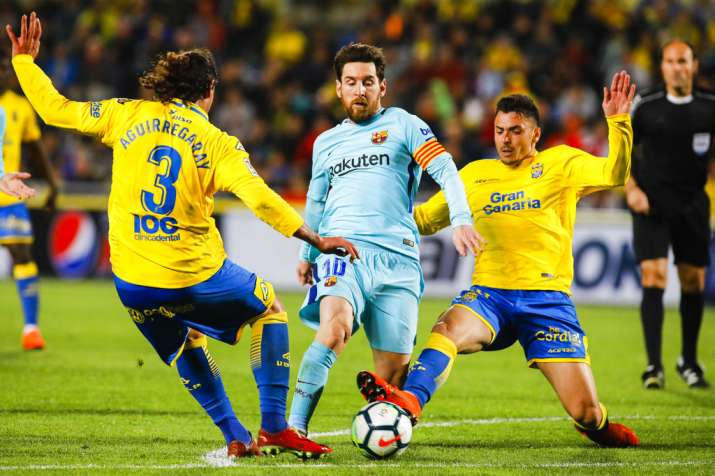 India Tv - Las Palmas defenders kept Messi quiet for a while.