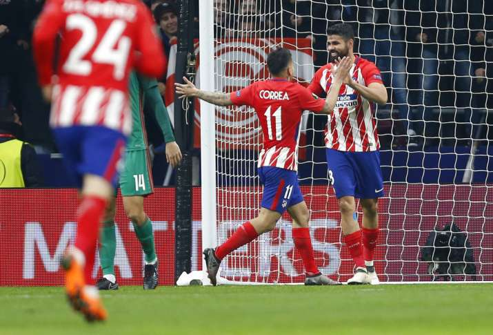 India Tv - Atletico Madrid players celebrate after scoring