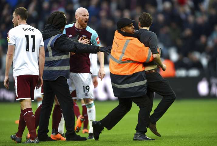 India Tv - West Ham fan confronts James Collins during the match