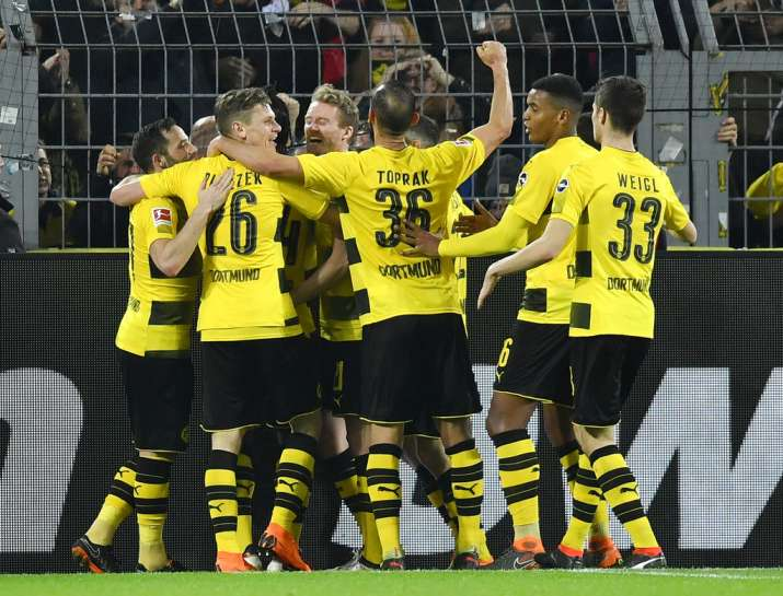 Dortmund players celebrate after scoring against Frankfurt