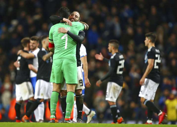 India Tv - Juventus teammates Buffon and Higuain hug it out after the friendly