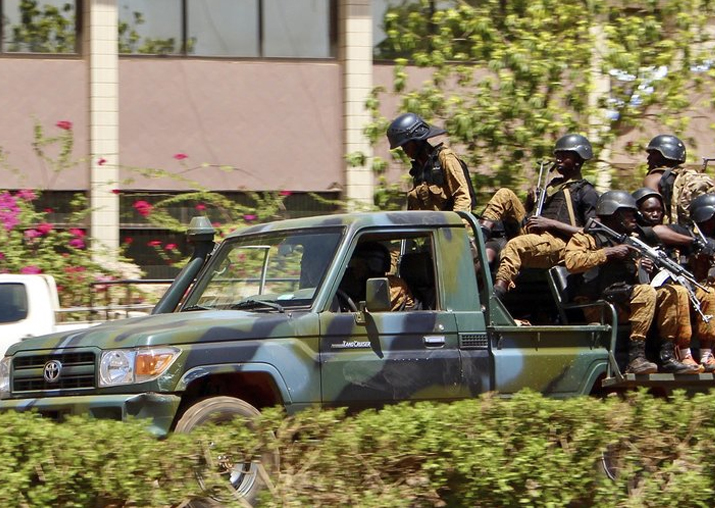 Troops ride in a vehicle near the French Embassy in central