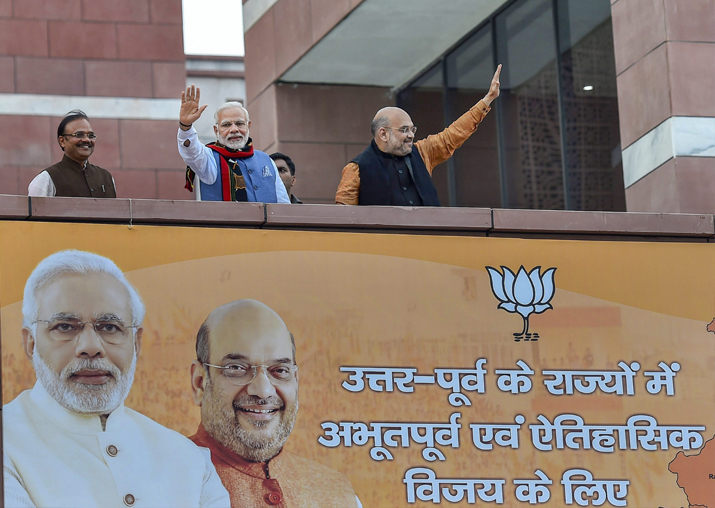 India Tv - Prime Minister Narendra Modi and BJP President Amit Shah wave as they arrive to address BJP party workers after their victory in North-East Assembly election at party headquarters in New Delhi on Saturday.