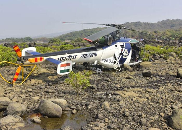 Coast Guard helicopter pilot hurt in crash landing dies