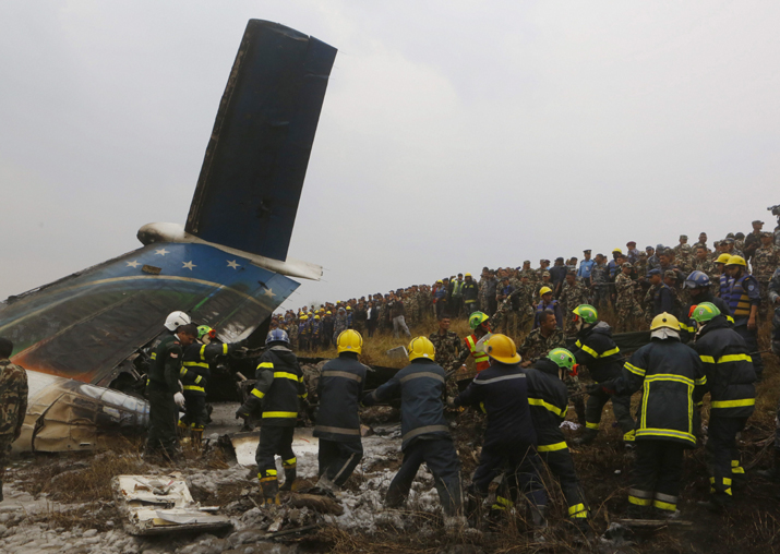 India Tv - Nepalese rescuers work after a passenger plane from Bangladesh crashed at the airport in Kathmandu