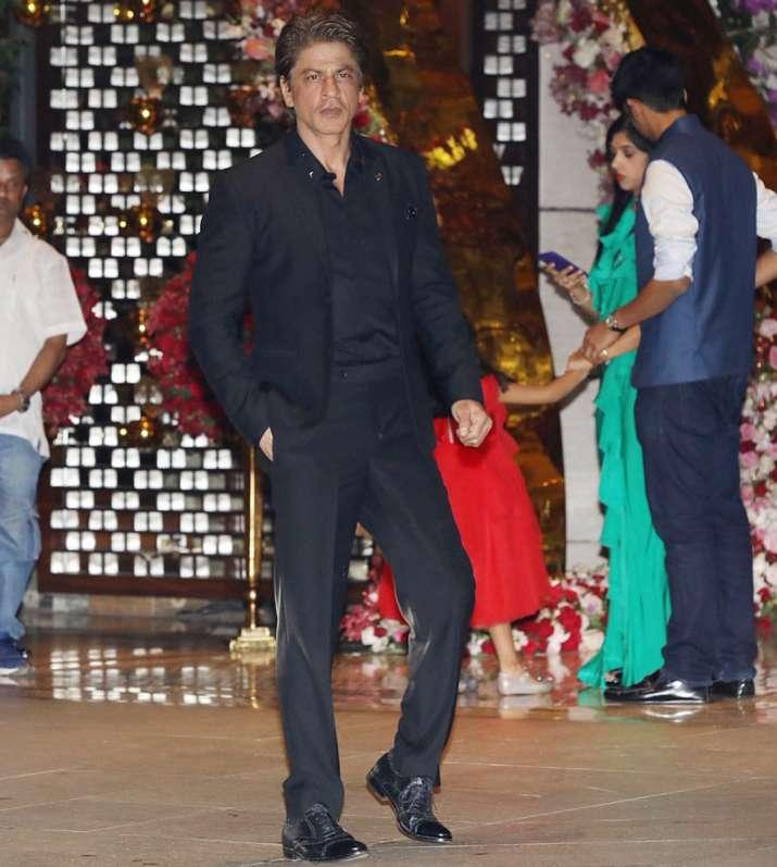 India Tv - Bollywood superstar Shah Rukh Khan poses for shutterbugs outside Ambani's Mumbai residence Antillia