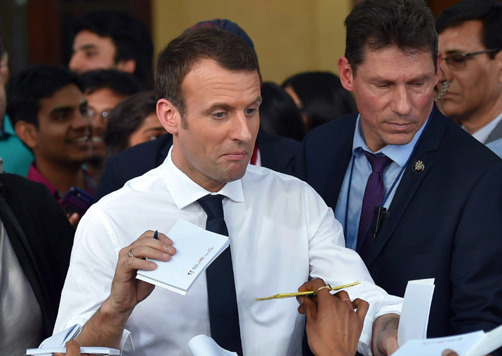 French President Emmanuel Macron interacts with students at